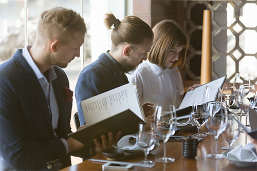 People reviewing the wine list