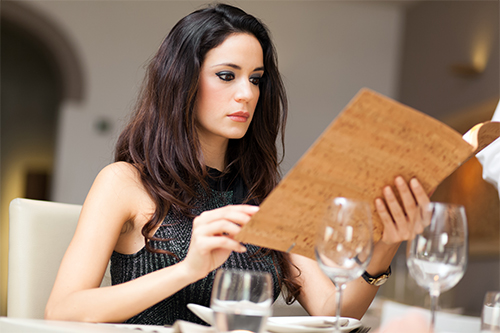 Woman reviewing the wine list