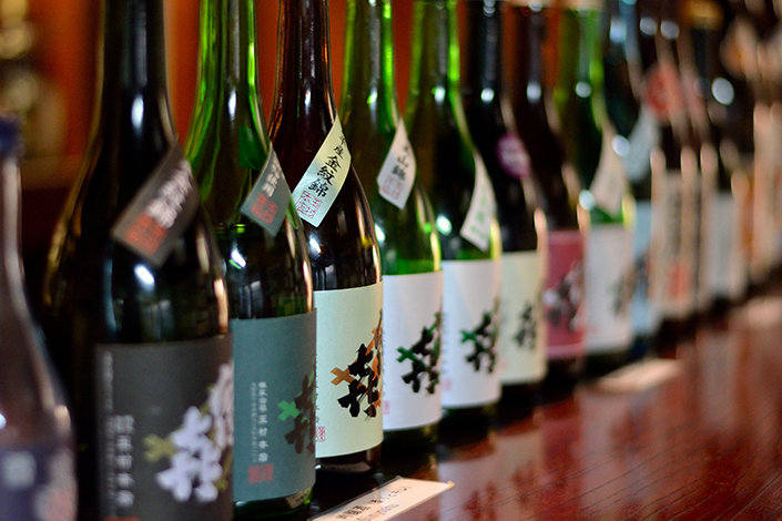 Row of sake bottles
