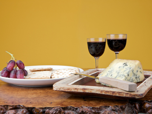 A pairing of stilton cheese with port wine and grapes