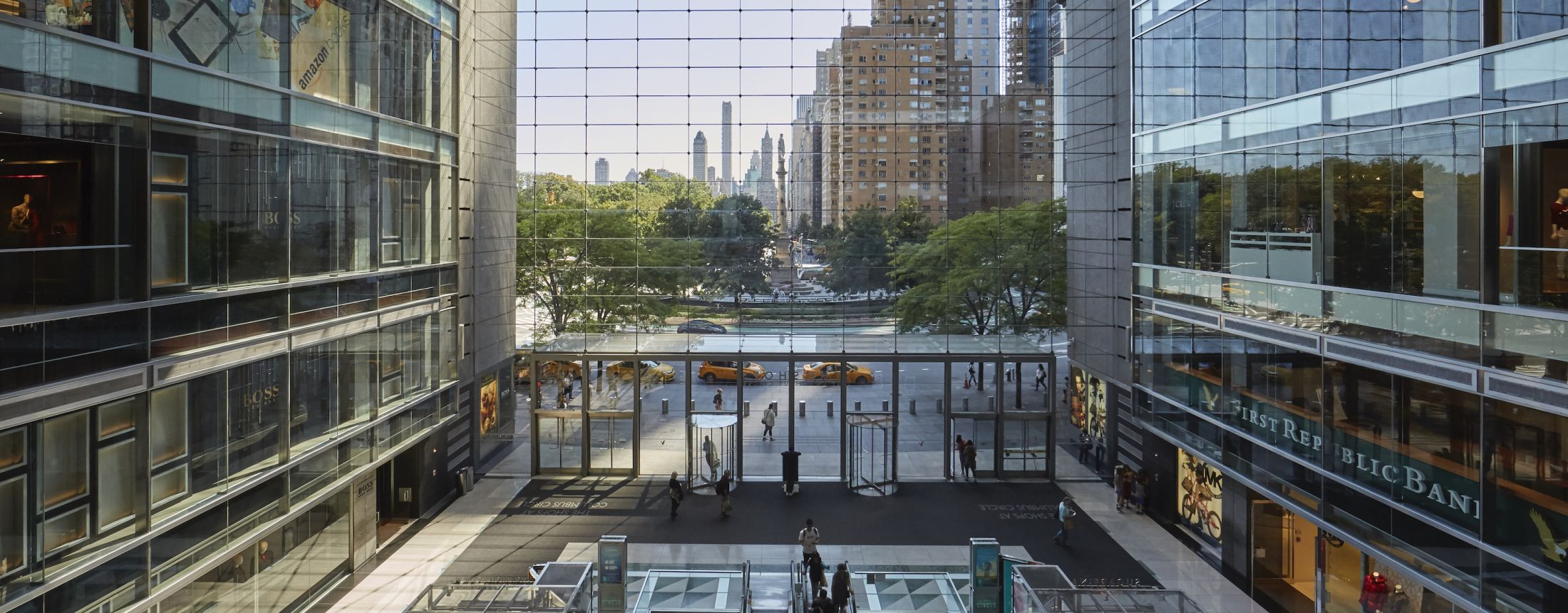 Large open area with glass windows and escalators in The Shops at Columbus Circle