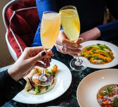 Cheers-ing mimosas at Bluebird London